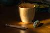 Bamboo cup, a pencil and an eraser