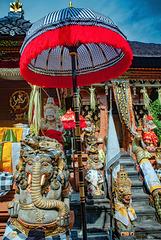 Umbrella above the statues