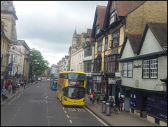 yellow bus in the high street