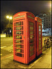 old phone boxes at night