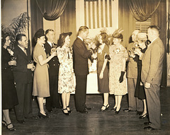 Toasting the bride and groom in the Vintage Photos Theme Park, 14 Feb 1946.