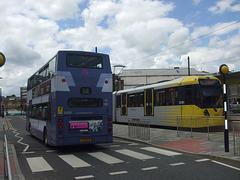 DSCF0484 First Manchester YJ51 RCZ abd Metrolink tram set 3080