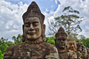 Statues of Gods lining the causeway entering the ancient city of Angkor Thom near Siem Reap, Cambodia