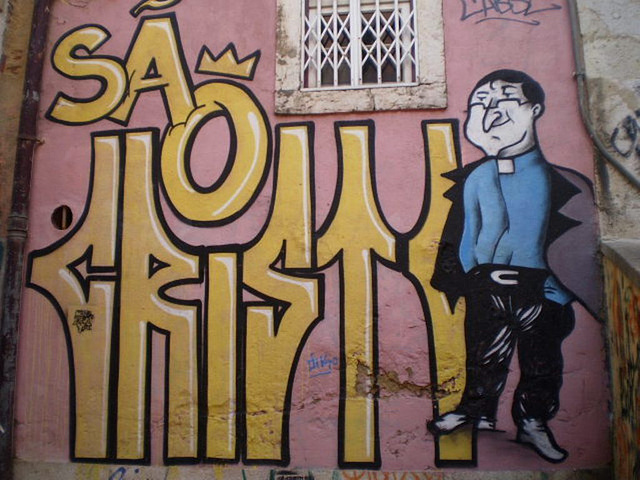 Street art at Alfama, Lisbon - Saint Christopher.