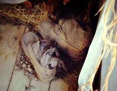 Boots, abandoned barn