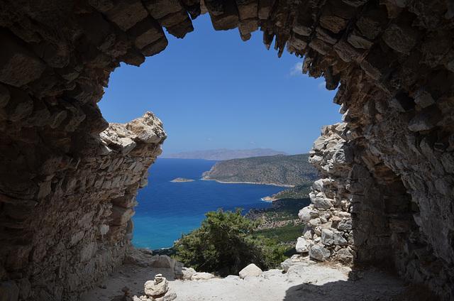 Rhodes, The Monolithos Castle, Looking through the Ruins of St.Panteleimon Church to the Armenistis Сape