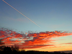Sunset with a contrail.
