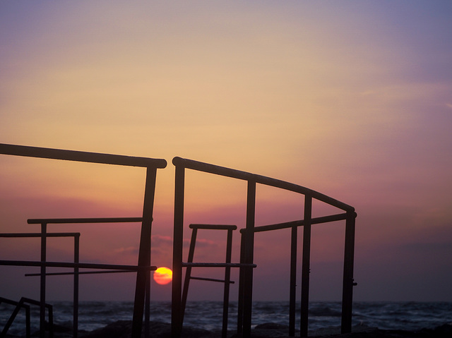 Sunset thru the fence