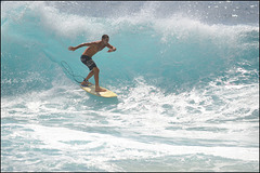surfing at Sandy Beach