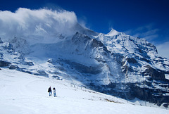 Young couple exploring Jungfau, near to Lauterbrunnen