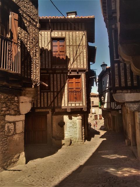 Street scene, a village (possibly La Alberca) in Salamanca Province.