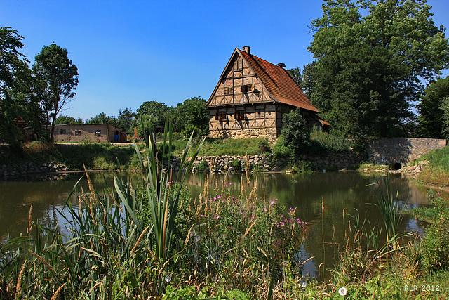 Grundshagen, ein Haus am Teich