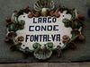 Ceramic plaque with square's name.