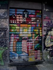 Graffiti on shop's blinds.