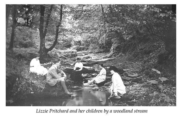 Lizzie Pritchard with her children in the woods c1920