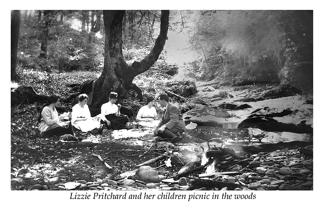 Lizzie Pritchard with her children picnic in the woods c1920
