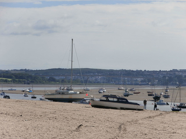 Some boats are beached with the tide out