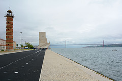 Belem Lighthouse, Monument to the Discoverers and Bridge of 25 April across Tagus River in Lisbon