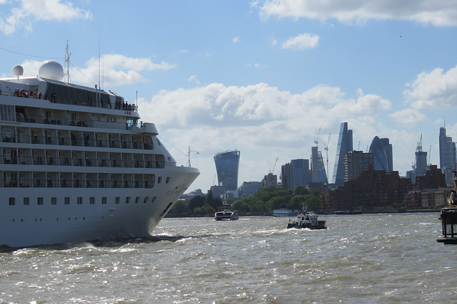 cruise ship approaching the city along the thames