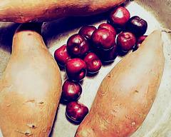 Arrangement of cherries and sweet potatoes