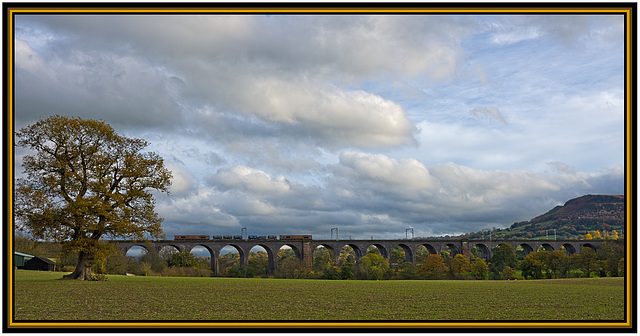 An Autumn special train heads right over North Rode Viaduct