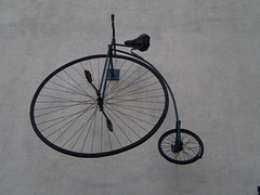 Bicycle on the wall.