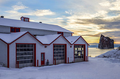 Winter Sunrise at Fire Station next to the Ocean in Gaspesie, Quebec, Canada