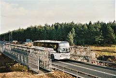 Ambassador Travel 100 (F100 BPW) on the A11 near Fiveways, Barton Mills – 16 Jan 1994 (213-7A)