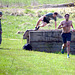 The first obstacle in the course is two low walls with a mud pit in between