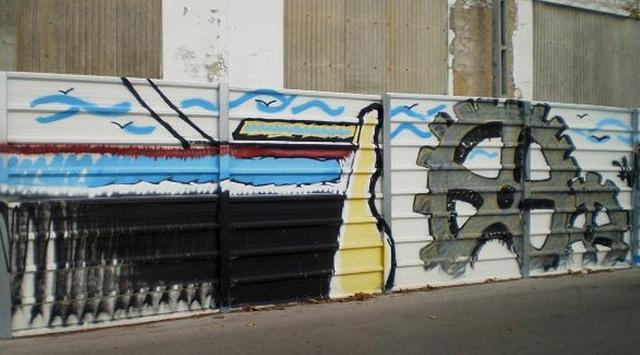 On fence of Mundet, a former cork factory.