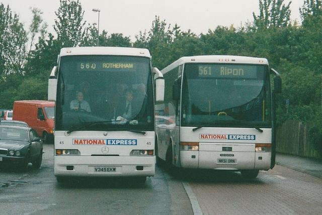Yorkshire Traction V345 EKW and Durham Travel NK51 ORN at Milton Keynes - 6 Jun 2002
