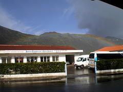 Heavy shower with rainbow.