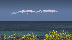 Flying snowy Olympus mountain