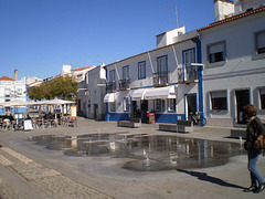 Water jets and terrace in the square.