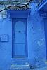 Blue door with nails