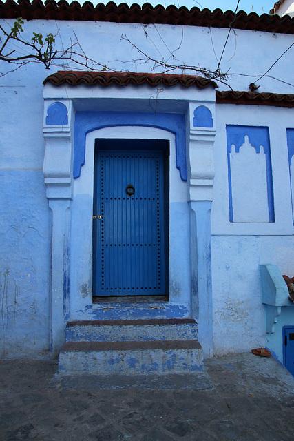 Blue door with pillars