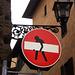 Street art on road sign.