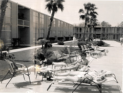 Slowly roasting family by the Hilton Pool, New Orleans, 1960.