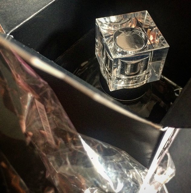 Unwrapping my new perfume.