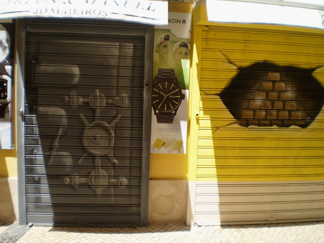 Painting on blinds of door and shop-window of jewellery.