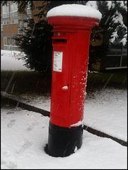 snow-topped pillar box