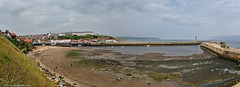 Whitby Harbour and Tate Hill beach at low tide