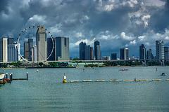 Skyline with Singapore Flyer ferris wheel seen from Marina Barrage