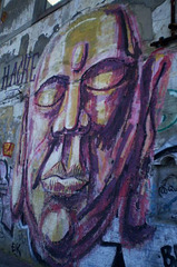 Face on wall of abandoned building.