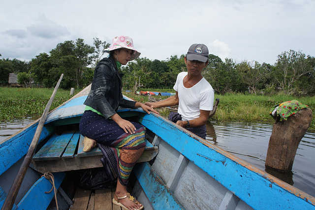 Phyu Phyu and motorboat driver