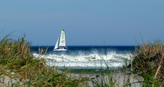 Sailing behind the surf