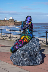 One of New Brighton 's mermaid statues