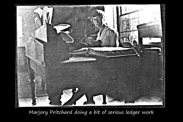 Marjory Pritchard doing a bit of serious ledger work c1925
