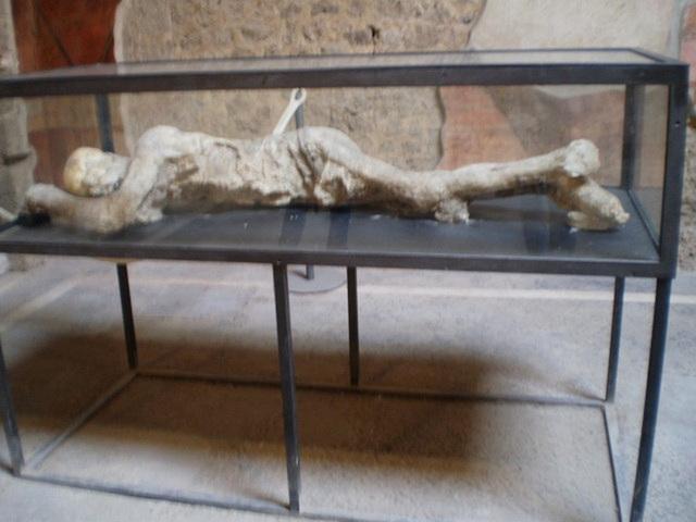 Replica in plaster of victim of Vesuvius eruption.