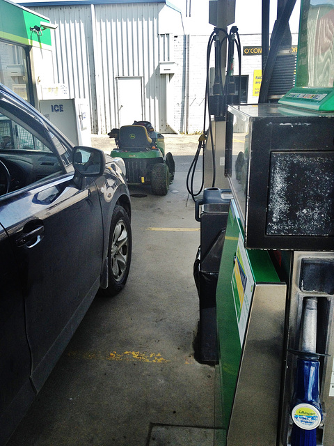 ride on mower at the petrol station